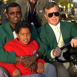 Vijay Singh holds his son Qass, 9, on his lap as he is driven by Billy Payne to a press conference after winning the Masters at the Augusta National Golf Club in Augusta, Ga., Sunday, April 9, 2000.