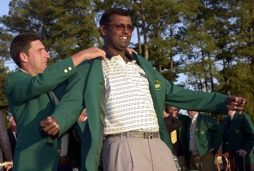 Jose Maria Olazabal puts the green jacket on Vijay Singh after Singh won the 2000 Masters.