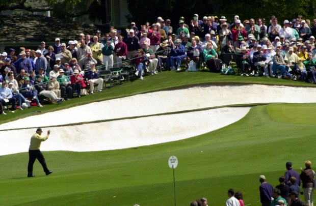 Jack Nicklaus waves to gallery as he walks up the ninth hole during final round play of the Masters.