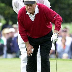 Jack Nicklaus and his caddie and son, Jack Nicklaus II on the first hole during the second round of the 2001 Masters.