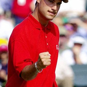 Chris DiMarco reacts to his par putt to end his second round of the 2001 Masters. DiMarco finished the round with two-day total of 10-under-par 134 for the tournament.