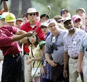 The gallery watches as Tiger Woods plays the first hole during the final round of the 2001 Masters.