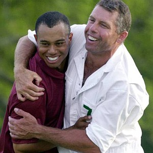 Steve Williams hugs Tiger Woods after Woods wins the 2001 Masters.