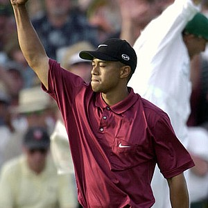 Tiger Woods on the 18th hole after winning the 2001 Masters at the Augusta National Golf Club in Augusta, Ga., Sunday, April 8, 2001. Woods captured this second Masters title, defeating David Duval by two strokes.