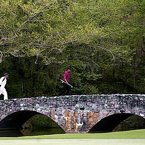 Tiger Woods and his caddie Steve Williams walk across the Byron Nelson Bridge during the final round of the 2001 Masters at the Augusta National Golf Club in Augusta, Ga.