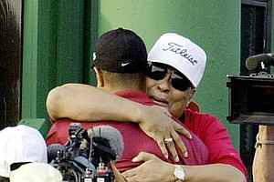 Earl Woods hugs his son, Tiger Woods, after Woods won the 2001 Masters.