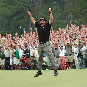 Phil Mickelson celebrates after winning the Masters golf tournament with a nine-under-par at the Augusta National Golf Club in Augusta, Ga.