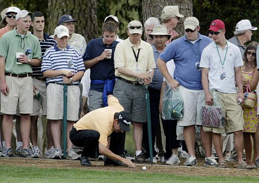 The gallery watches Jose Maria Olazabal on eighth fairway during the final round of the Masters golf tournament.