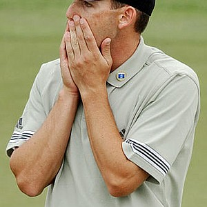 Sergio Garcia reacts after his ball stops short of the hole on the 18th green to miss a birdie during the final round of the Masters golf tournament.