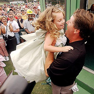 Phil Mickelson hugs his daughter, Amanda Brynn, after winning the 2004 Masters golf tournament at the Augusta National Golf Club in Augusta, Ga., on Sunday, April 11, 2004.