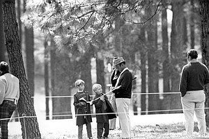 Three-time Masters champion Sam Snead stops to sign his autograph for young fans during a practice round of the Masters tournament at the Augusta National Golf Club in Augusta, Ga., April 6, 1973.