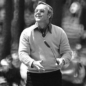 Arnold palmer reacts with the gallery to missing a birdie putt on the third green Thursday April 5, 1973 during the first round of play in the 1973 Masters at Augusta, Ga.