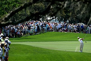 Large crowds line the fairway at No. 1 as Tiger Woods hits his second shot during Round 1 of the Arnold Palmer Invitational at Bay Hill Club & Lodge.