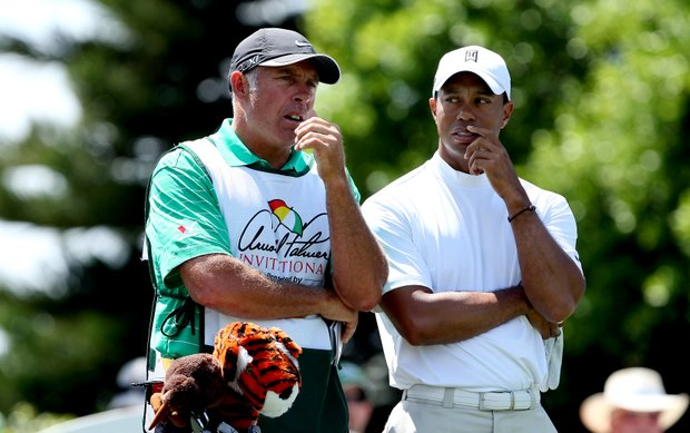 Tiger Woods talks with his caddie Steve Williams at No. 2 during Round 1 of the Arnold Palmer Invitational at Bay Hill Club & Lodge.