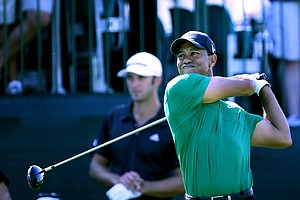 Tiger Woods hits his tee shot at No. 18 during Round 2 of the Arnold Palmer Invitational at Bay Hill Club & Lodge.