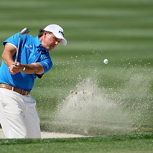 Phil Mickelson hits out of the bunker at No. 6, where he took a triple bogey.