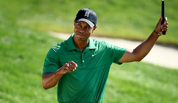 Tiger Woods after making a 53-foot birdie putt on the 18th hole Friday at Bay Hill. Woods shot a second-round 68.