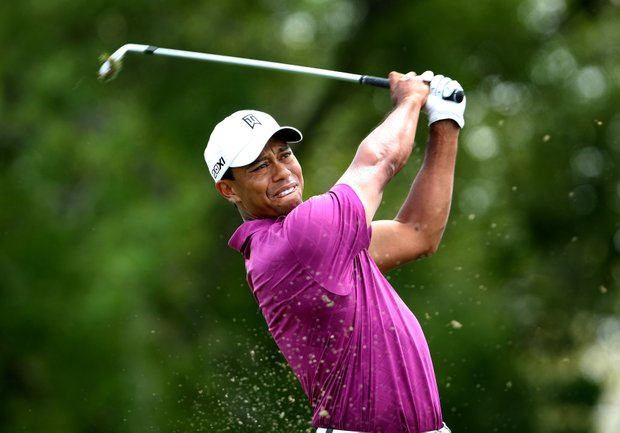 Tiger Woods hits his tee shot at No. 7 during Round 3. Woods made par.