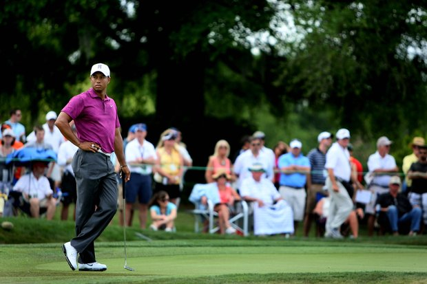 Tiger Woods waiting to putt at No. 7, he made par.