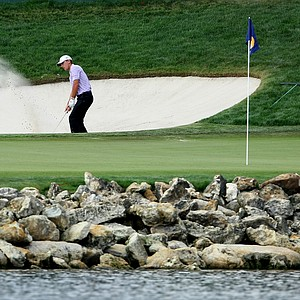 Charles Howell III hits a bunker shot at No. 18, away from the pin.