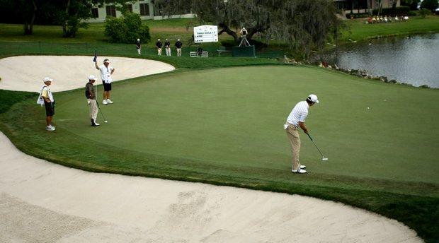 Martin Laird attempts a birdie putt at No. 18.