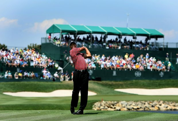 Tiger Woods hits his tee shot at No. 16 during the final round of the Arnold Palmer Invitational at Bay Hill Club & Lodge. In the background is the 18th hole grand stands.