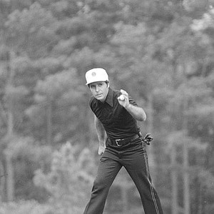 Gary Player of South Africa, holds his golf ball after he sunk a birdie on the seventeenth green to go 10-under int he Masters Tournament at Augusta, Ga., April 15, 1974.