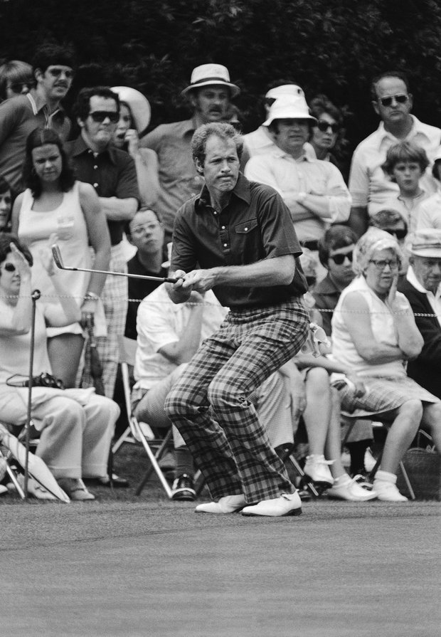 Tom Weiskopf bends as he watches his putt near the cup on the fourth green. The ball went in for a birdie during the final round of the Masters Gold Tournament Apr. 14, 1974 at the Augusta National Golf Club.
