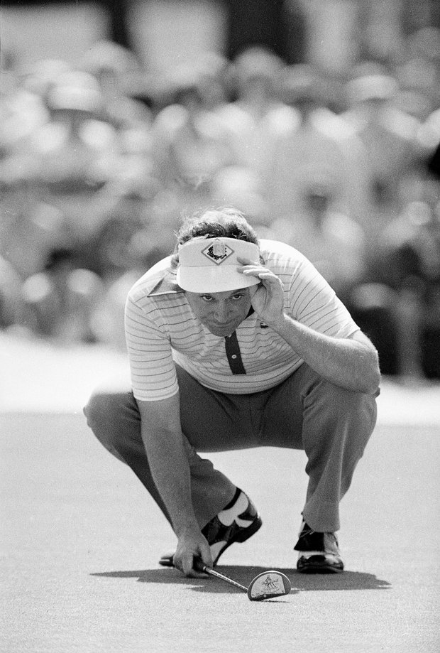 Ray Floyd is seen as he lines up a putt on the second at Augusta National Golf Course during the final round of the Masters Championship on April 11, 1976.