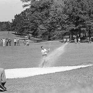 Jimmy Demaret, two-time Masters Tournament champion, sends his ball out of the sand trap on the edge of the second green during the Masters in Augusta, Ga., April 7, 1950.