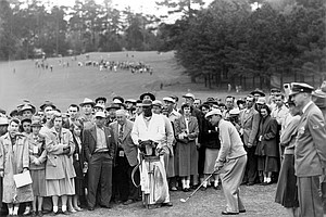 Ben Hogan, of Ft. Worth, Texas, chips out of the crowd to the 7th green after his approach shot rolled from the green and stopped five feet into the spectators in third round of the Masters Golf Tournament at Augusta National Golf Club in Augusta, Ga., on April 7, 1951.
