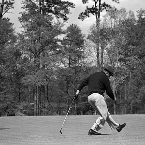 Sam Snead kicks out one foot and leaps for joy as his putt drops in for a par four on the sixth hole during the Masters Tournament in Augusta, Ga., April 5, 1952.