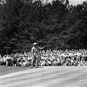 Ben Hogan, Palm Springs, Ca., holds his putter straight up as he watches his ball roll for the cup on the 15th green at the Augusta National Golf Club on April 11, 1953. Hogan entered the 3rd round of The Masters golf tournament with a low 139.