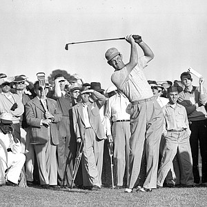 Cary Middlecoff puts his all into a shot from the 15th fairway during second round of Masters Golf Tournament April 8, 1955.