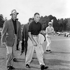 Sam Snead, left, and Ben Hogan stroll down the fairway on the eve of the Masters golf tournament at Augusta National Golf Club in Augusta, Ga., April 6, 1955.