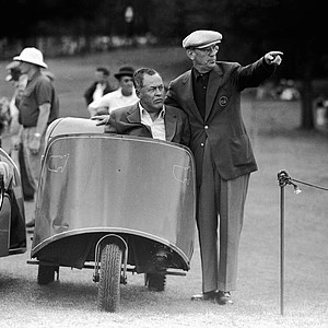 Cliff Roberts and Bobby Jones pose on the fairway during the Masters Golf Tournament in Augusta, Ga. Apr. 7, 1956.