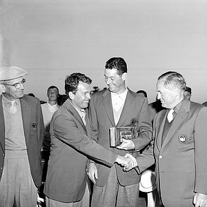 Jack Burke Jr., left, is congratulated by Bobby Jones after winning the 20th Masters Golf Tournament by one stroke at the Augusta National Golf Course in Augusta, Ga., April 8, 1956.