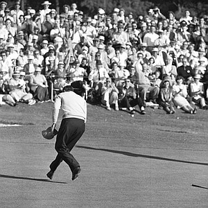 Art Wall Jr. throws down club and leaps over to retrieve ball from cup on 18th green after putting out in the final round of Masters Golf Tournament at Augusta, Ga., April 5, 1959. He fired a 66 for a total 284 to win the tournament.