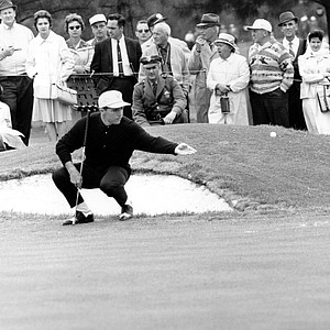 Gary Player tosses the ball to caddy from squatting position after he holed out at No. 2 in first round of Masters Tournament at Augusta National Golf Club in Augusta, Ga., on April 5, 1962.