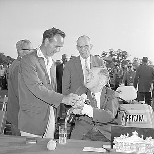 Arnold Palmer, left, presents the ball he used in winning the Masters Golf playoff, April 9, 1962, in Augusta, Ga., to Bobby Jones, president of the Augusta National Club where the tournament was played.