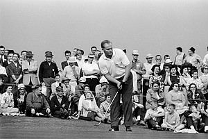 Jack Nicklaus, defending champion, is all business as he gets set to stroke a putt during practice round for the Masters Golf Tournament at Augusta, Ga. today, April 7, 1964.