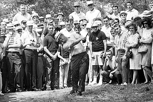 Jack Nicklaus hits a three-iron shot from deep in the woods along the 2nd fairway during the Masters Golf Championship at Augusta National Golf Club in Augusta, Ga., on April 10, 1965.