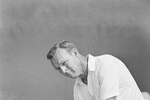 Arnold Palmer watches a drive in his final practice round for the Master Tournament on April 5, 1967 at Augusta National Golf Club.
