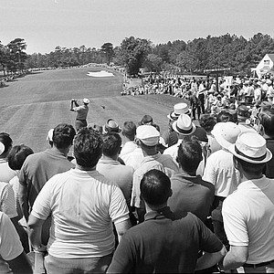 Specators ring the entire fairway from tee to green at Augusta National Golf Club Sunday, April 9, 1967 as veteran golfer Ben Hogan tees off in the final round of the Masters Tournament.