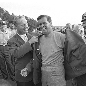 Gay Brewer grins as Jack Nicklaus helps him into his traditional green Blazer after winning the Masters Tournament at Augusta National Golf Club in Augusta, Ga. on April 9, 1967.