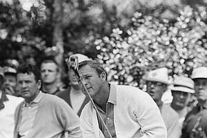 Arnold Palmer sights past his driver as he completes a practice round at Augusta National Golf Club, April 9, 1969, Augusta, Ga.
