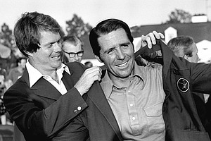 Tom Watson, 1977 Masters champion, places the green coat on Gary Player, right, winner of the Masters Golf Tournament at the Augusta National Golf Club in Augusta, Ga., April 9, 1978.
