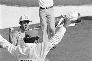 Gary Player of South Africa and his caddy let the crowd know they are happy as Player made a birdie shot on 18 to win the 1978 Masters Tournament in Augusta, Ga., April 9, 1978.(