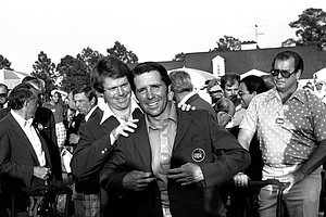 Tom Watson, left, last year's Masters winner is shown putting the Green Jacket of the August National Golf Club on the 1978 winner, Gary Player, April 10, 1978.