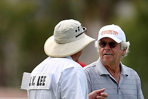 Actor William Devane talks with Jee Young Lee's caddie during Wednesday's pro-am.